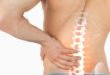 38348976 - digital composite of highlighted spine pain of man